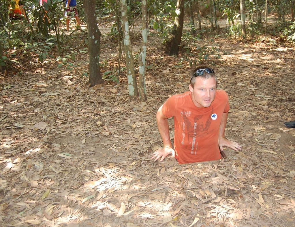 Photo Attempting To Enter the Cu Chi Tunnels network